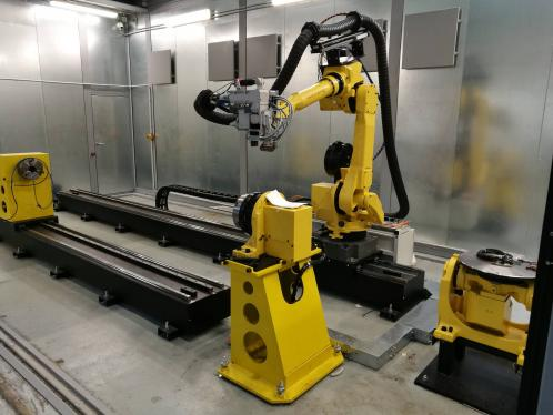 Laser welding workplace with robot and positioner FANUC